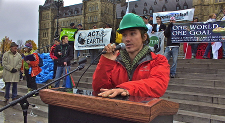 Rob Stewart is MC at an environment rally from the documentary Revolution