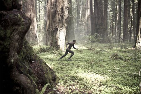 Kitai runs through the forest from the Columbia Pictures film After Earth