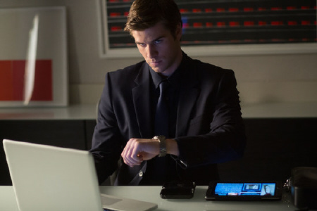 Adam checks his watch from the Relativity Media film Paranoia