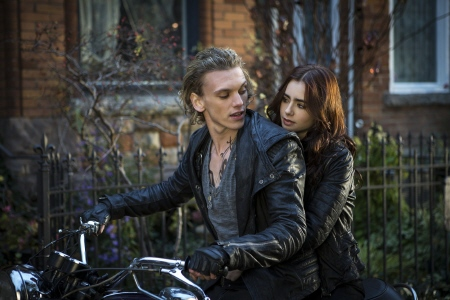 Clary and Jace ride a motorcycle from the Sony Pictures film Mortal Instruments City of Bones