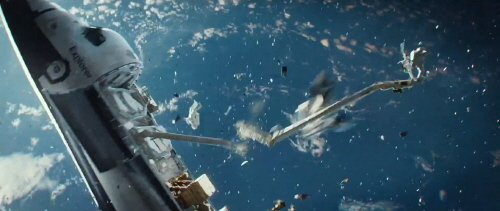Space shuttle Explorer is hit by debris from the Warner Bros. Pictures film Gravity