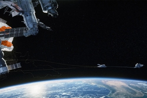 Stone and Kowalsi are caught on ISS from the Warner Bros. Pictures film Gravity