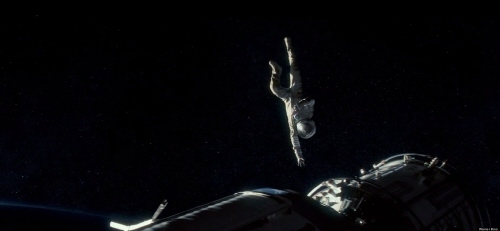 Stone tries to grab onto the Chinese Space Station from the Warner Bros. Pictures film Gravity