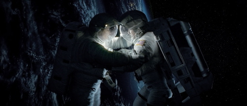 George Clooney and Sandra Bullock from the Warner Bros. Pictures film Gravity