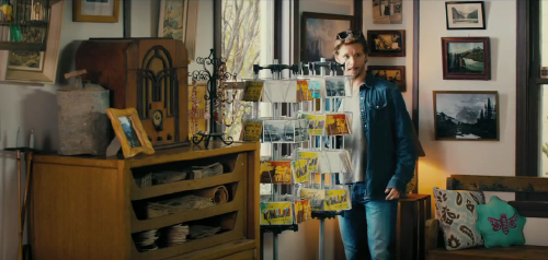 Leo looks at postcards from the Serendipity Point Films movie The Right Kind of Wrong