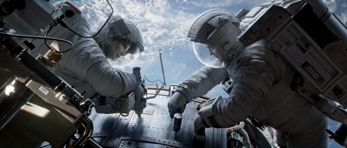 Stone and Kowaksi work on the Hubble telescope from the Warner Bros. Pictures film Gravity
