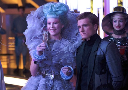 Effie Trinket and Peeta at a party from the Lionsgate film Hunger Games 2 Catching Fire