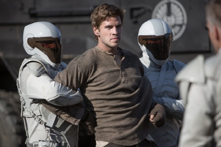 Peacekeepers arrest Gale from the Lionsgate film Hunger Games 2 Catching Fire