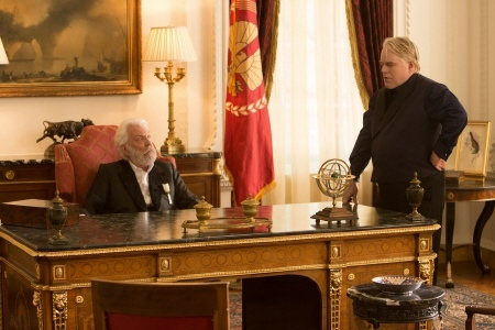 President Snow plots with Plutarch Havensbee from the Lionsgate film Hunger Games 2 Catching Fire