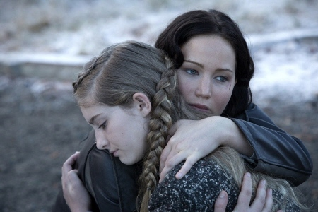 Katniss hugs Primrose from the Lionsgate film Hunger Games 2 Catching Fire