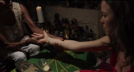 Sam getting a palm reading from the 20th Century Fox film Devils Due