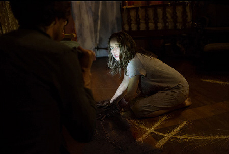 Sam scratches symbols in the floor from the 20th Century Fox film Devils Due
