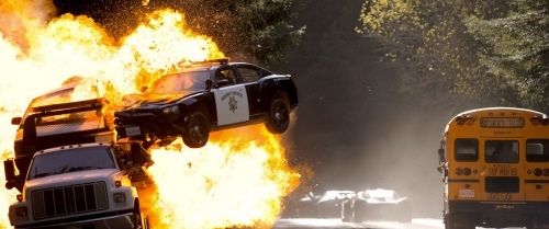 Cop cars blow up in the Walt Disney Pictures film Need for Speed