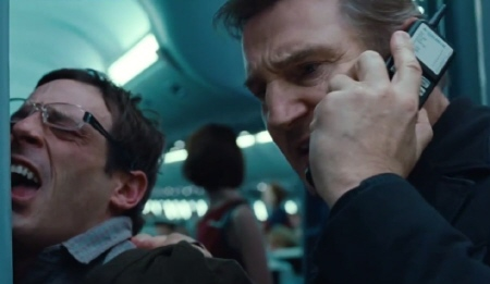 Scoot McNairy and Liam Neeson from the Universal Pictures film Non-Stop