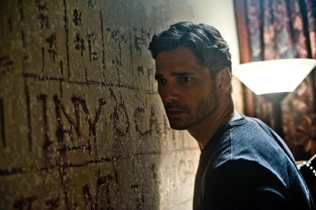 Eric Bana looks at creepy writing from the Sony Pictures film Deliver Us From Evil