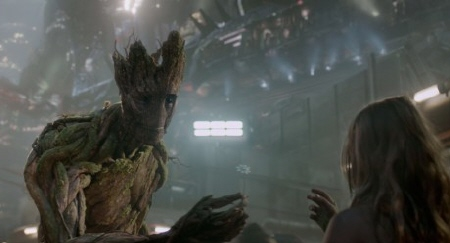 Groot gives a girl a flower from the Marvel Studios film Guardians of the Galaxy