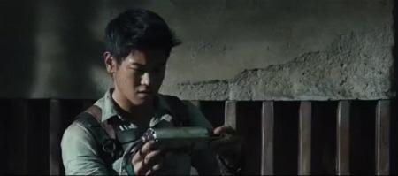 Minho inspects Griever innards from the 20th Century Fox film Maze Runner