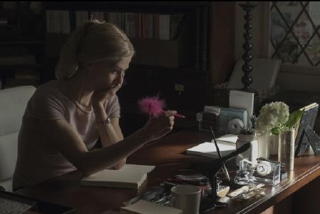 Rosamund Pike writes a diary in the Twentieth Century Fox film Gone Girl